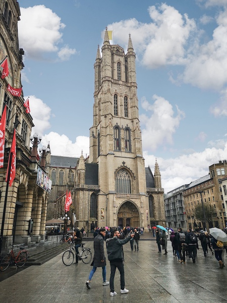 people standing in front of the St Bavo's Cathedral, Ghent