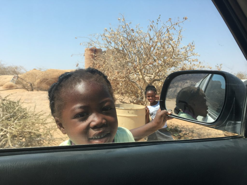 Girls asking for sweets in Namibia