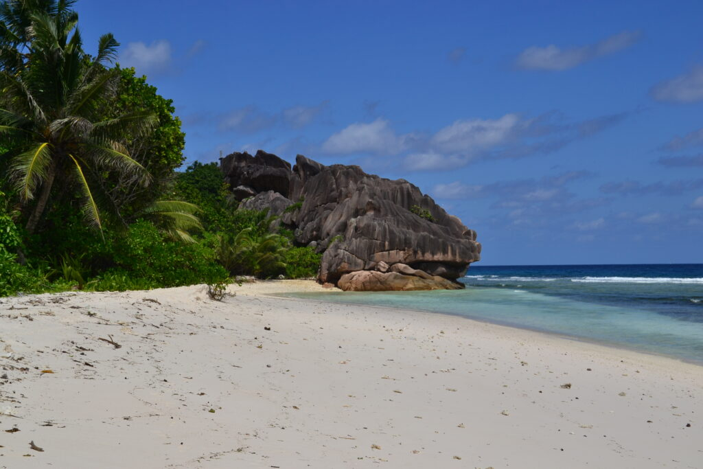 The large boulder that gives the name: Anse Grosse Roche, A Complete Guide to La Digue Island in Seychelles
