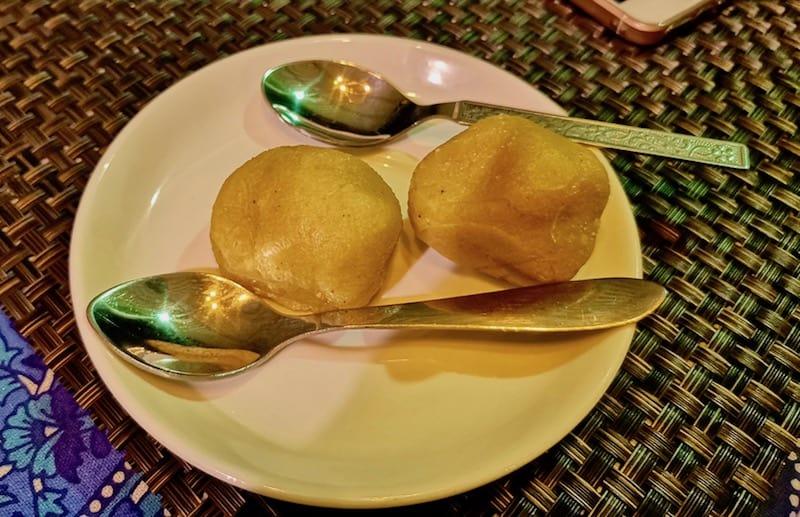 GHOTUA LADOO,a traditional sweet made with khoya, besan, and sugar.