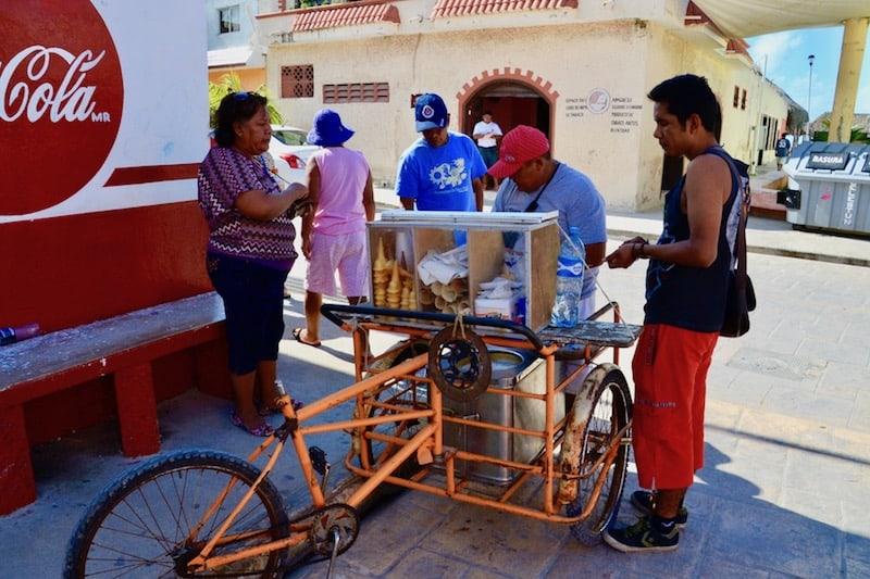 man selling ice-cream in Celestun, Mexico