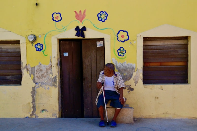 man standing in front of his house in Celestun, Mexico