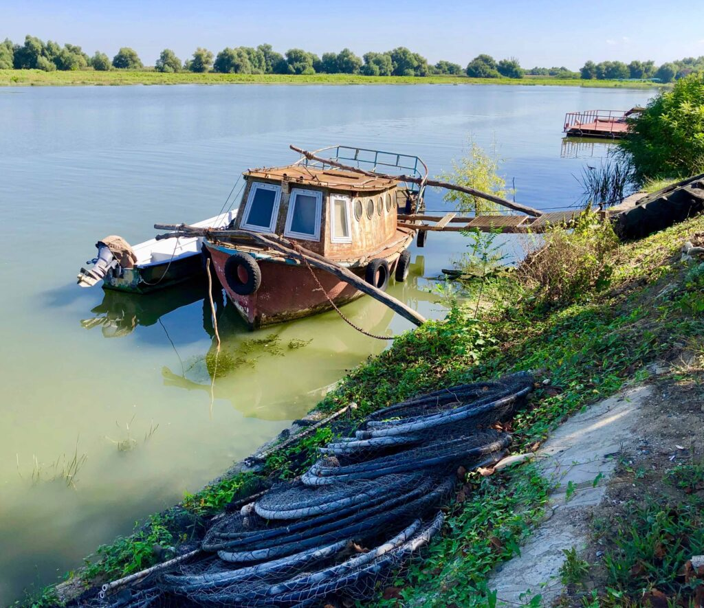 A Complete Guide To The DANUBE DELTA, Romania, An old fishing boat at Mila 23.